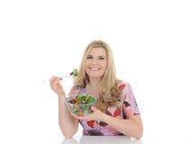Casual woman eating healthy green vegetable salad Royalty Free Stock Photography