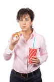 Casual woman eating pizza Royalty Free Stock Images