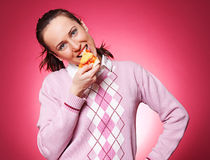 Casual woman eating pizza Royalty Free Stock Image