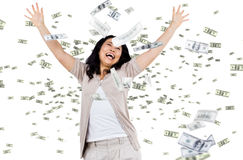 Casual woman with falling money. Digital composite of business models with falling money Stock Photography