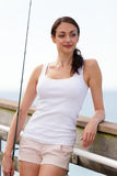Casual woman with a fishing pole Stock Photos
