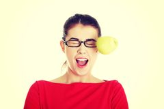 Casual woman in glasses hit by apple Stock Images