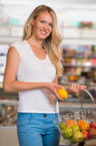 Casual woman grocery shopping at organic food section Royalty Free Stock Photos