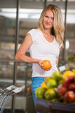 Casual woman grocery shopping at organic food section Royalty Free Stock Photo