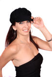 Casual woman with hat. Casual woman dressed in a funky wool hat, and  black bustier  on a white background Royalty Free Stock Image