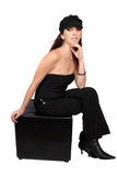 Casual woman with hat. Casual woman dressed in a funky wool hat, and  black bustier  on a white background Stock Photos