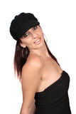 Casual woman with hat. Casual woman dressed in a funky wool hat, and  black bustier  on a white background Royalty Free Stock Photos