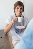 Casual woman having a coffee with friend Royalty Free Stock Photography