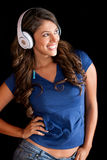 Casual woman with headphones Stock Photography