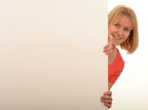Casual woman holding a blank white sign Stock Photo