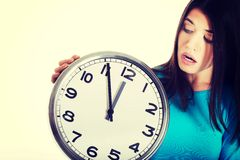 Casual woman holding a clock. Stock Photo