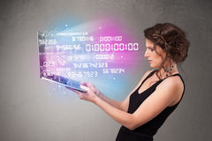 Casual woman holding laptop with exploding data and numers. Attractive casual woman holding laptop with exploding data and numers stock photos