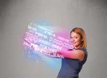 Casual woman holding laptop with exploding data and numers Royalty Free Stock Image