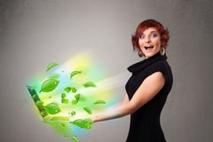 Casual woman holding notebook with recycle and environmental sym Royalty Free Stock Photography