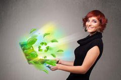 Casual woman holding notebook with recycle and environmental sym stock image