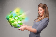 Casual woman holding notebook with recycle and environmental sym Royalty Free Stock Photos