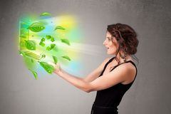 Casual woman holding notebook with recycle and environmental symbols royalty free stock photography