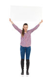 Casual Woman Holding Placard Above Her Head Royalty Free Stock Image