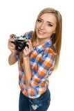 Casual woman holding retro camera Stock Photos