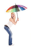 Casual woman holding umbrella Royalty Free Stock Photo