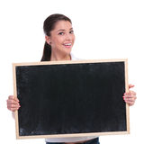 Casual woman holds blackboard Royalty Free Stock Image