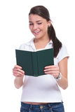 Casual woman holds book Royalty Free Stock Images
