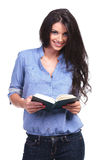 Casual woman holds an opened book Royalty Free Stock Photos