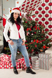 Casual woman inf ront of Christmas tree Stock Photography