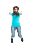 Casual woman jumping showing OK. Royalty Free Stock Photography