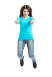 Casual woman jumping showing OK. Royalty Free Stock Images