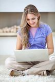 Casual woman with laptop Stock Photography