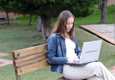 Casual woman on laptop Stock Image