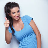 Casual woman making the ok thumbs up hand sign Stock Photo