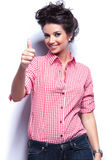 Casual woman making the thumbs up ok sign Stock Photo