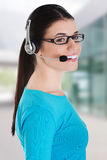 Casual woman with microphone and headphones. Royalty Free Stock Images