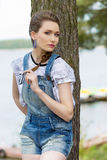 Casual woman near lake Stock Photos
