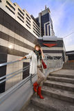 Casual woman near modern building Royalty Free Stock Photography