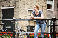Casual Woman in Old Town Stock Images