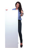 Casual woman with pannel shows thumb up Royalty Free Stock Photography