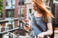 Casual Woman with a Phone in an Old Town Royalty Free Stock Photography