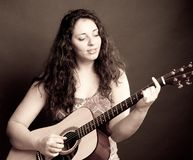 Casual woman playing guitar Stock Photography