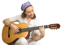 Casual woman playing guitar Royalty Free Stock Photography