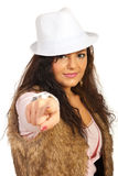 Casual woman pointing to you. Casual woman with hat and fur jacket pointing to you isolated on white background Royalty Free Stock Photo