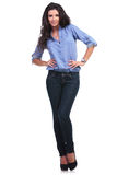 Casual woman posing with hands on hips Royalty Free Stock Images