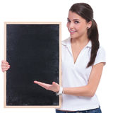 Casual woman presenting blackboard Royalty Free Stock Images