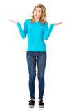 Casual woman presenting a copyspace. Stock Photography