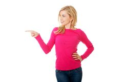 Casual woman presenting a copyspace. Royalty Free Stock Photo