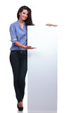 Casual woman presents a blank pannel Stock Images