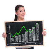 Casual woman presents growing graph Stock Photo