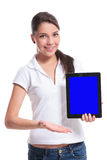 Casual woman presents tablet Stock Image
